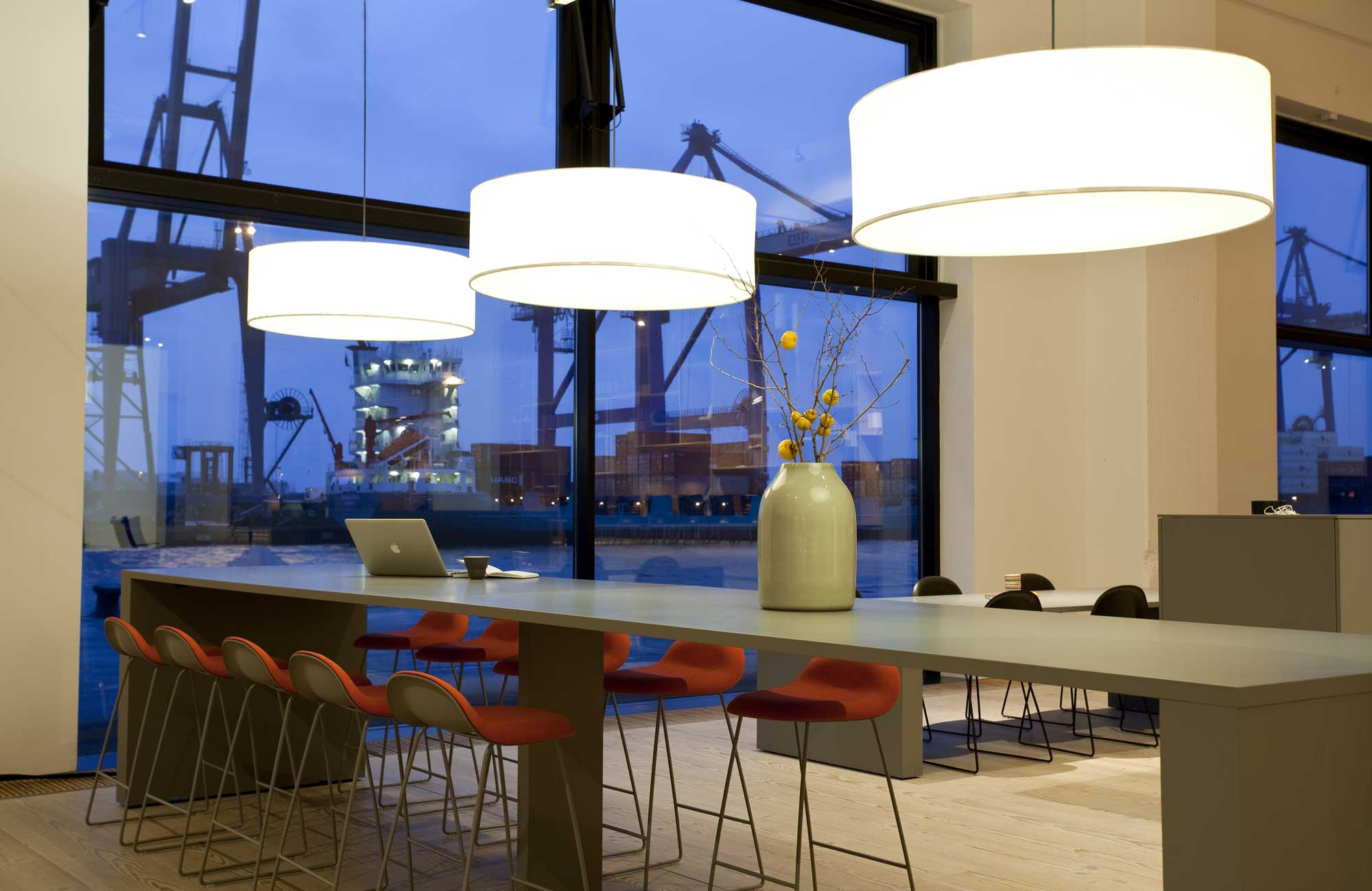 Embacco Lighting Fab lamp over table at Gubi Copenhagen
